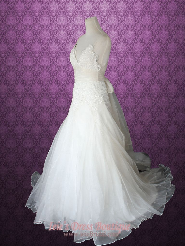 Whimsical cross back organza v neck aline beach lace wedding gown