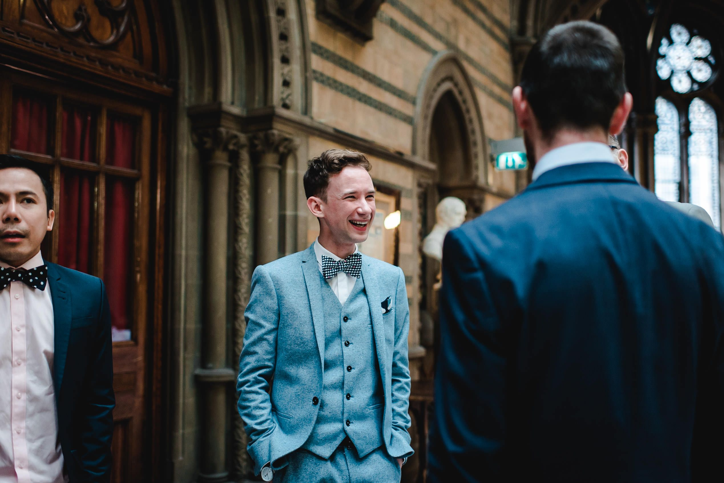 Wedding guest laughing at Manchester Town Hall wedding by Amy Louise ...