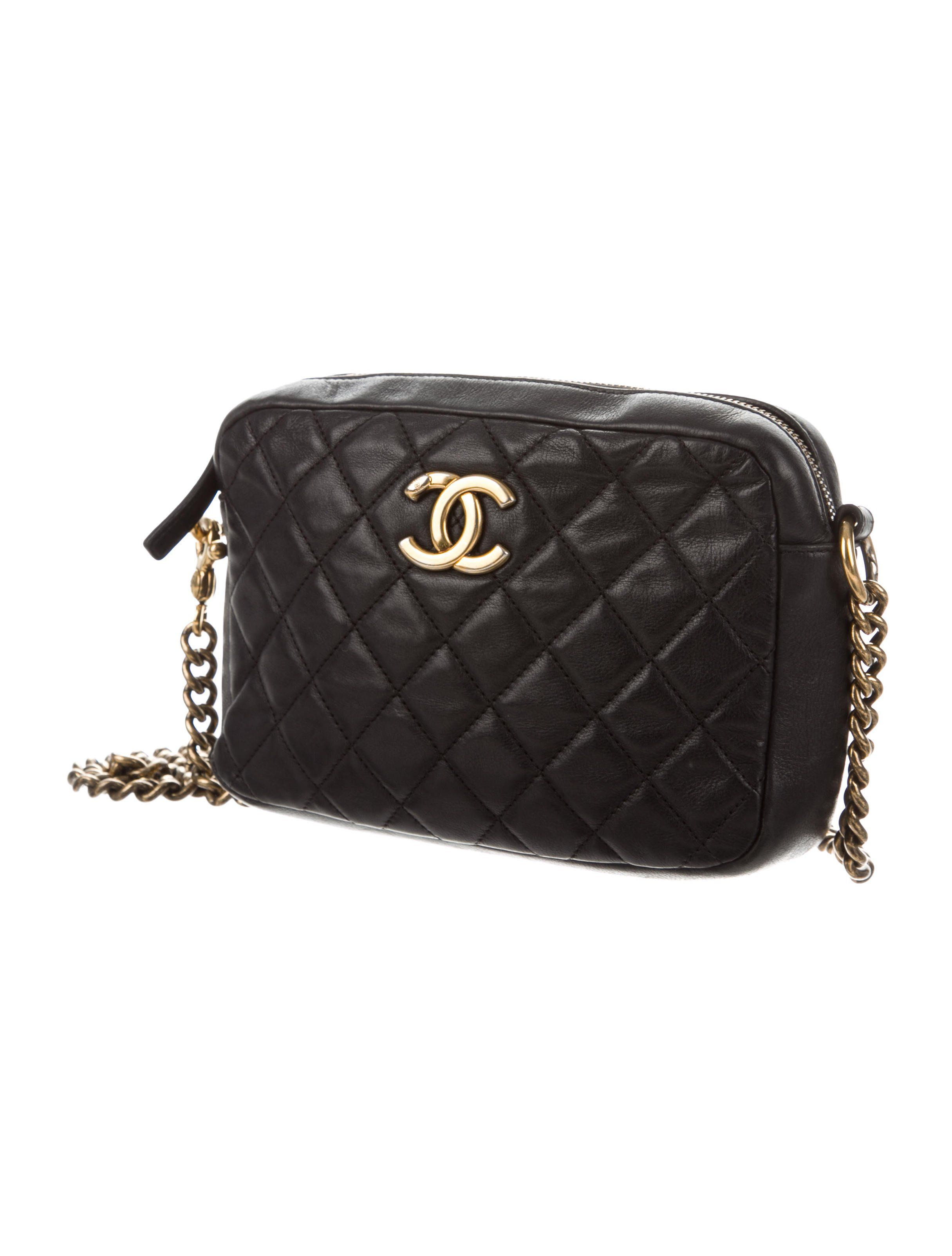 a32411c7ec1811 Black quilted lambskin Chanel CC Crown Camera Bag with gold-tone hardware,  tonal stitching, logo at exterior, single chain-link and leather shoulder  strap,