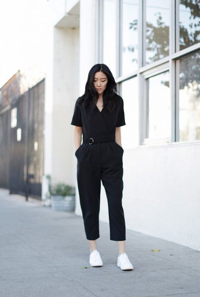 451b042577ed Blogger Andy Heart wears a belted black jumpsuit with white sneakers