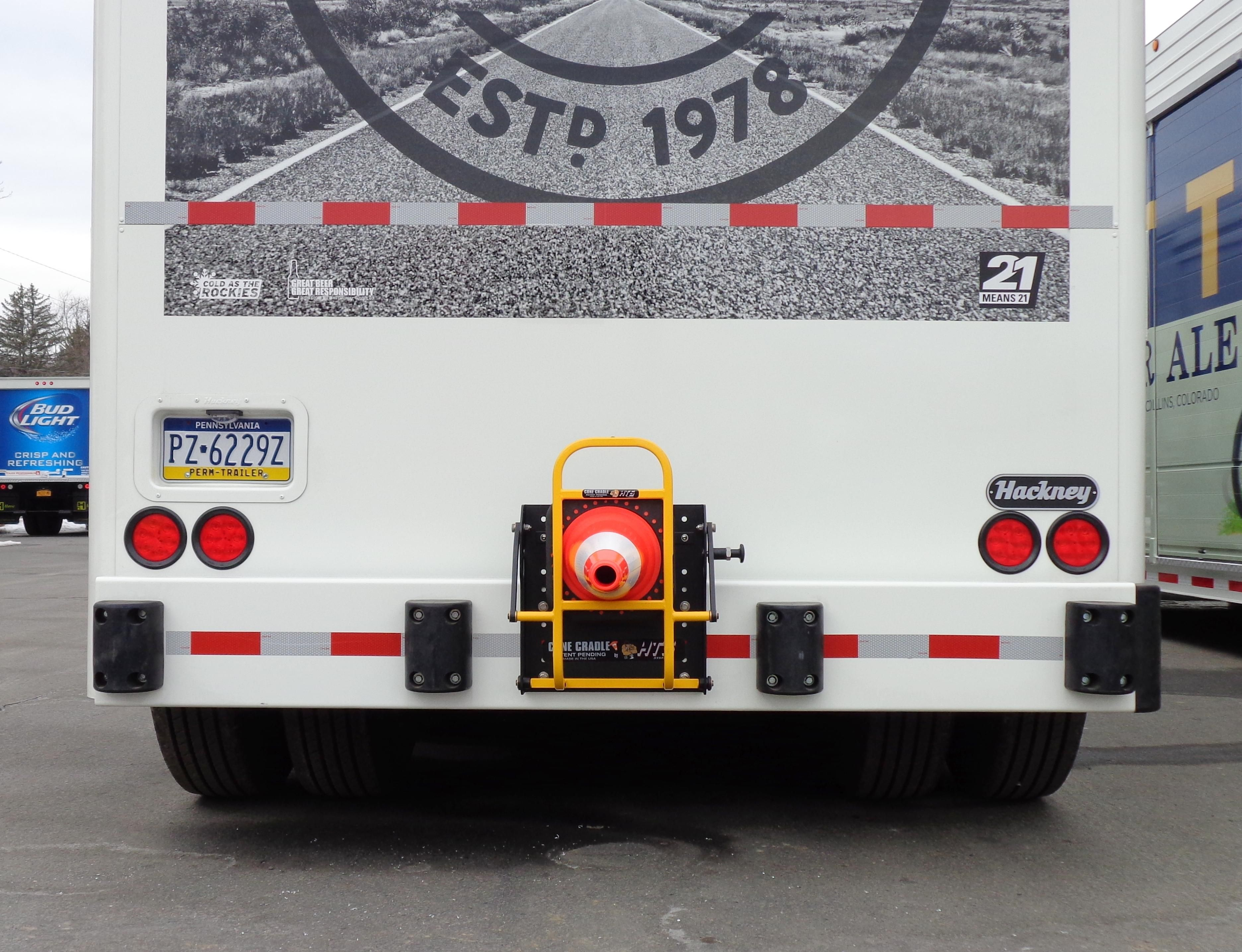 HTS Systems' HTS-CC-18V vertical mount Cone Cradle opens to 90° degrees, an excellent safety application for side-loader beverage trucks. Deploy and stow traffic safety cones in just seconds! Create a safe work perimeter when making deliveries safely, quickly and easily.