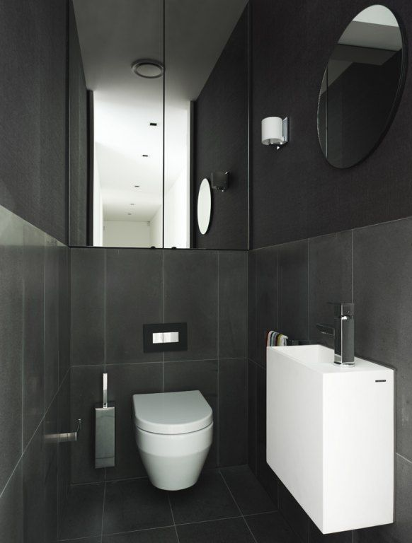 Black Modern Bathroom Toilet. Looks like mirrored cupboards to ceiling above toilet suite with Inwall  cistern Narrow BathroomModern Dramatic powder room