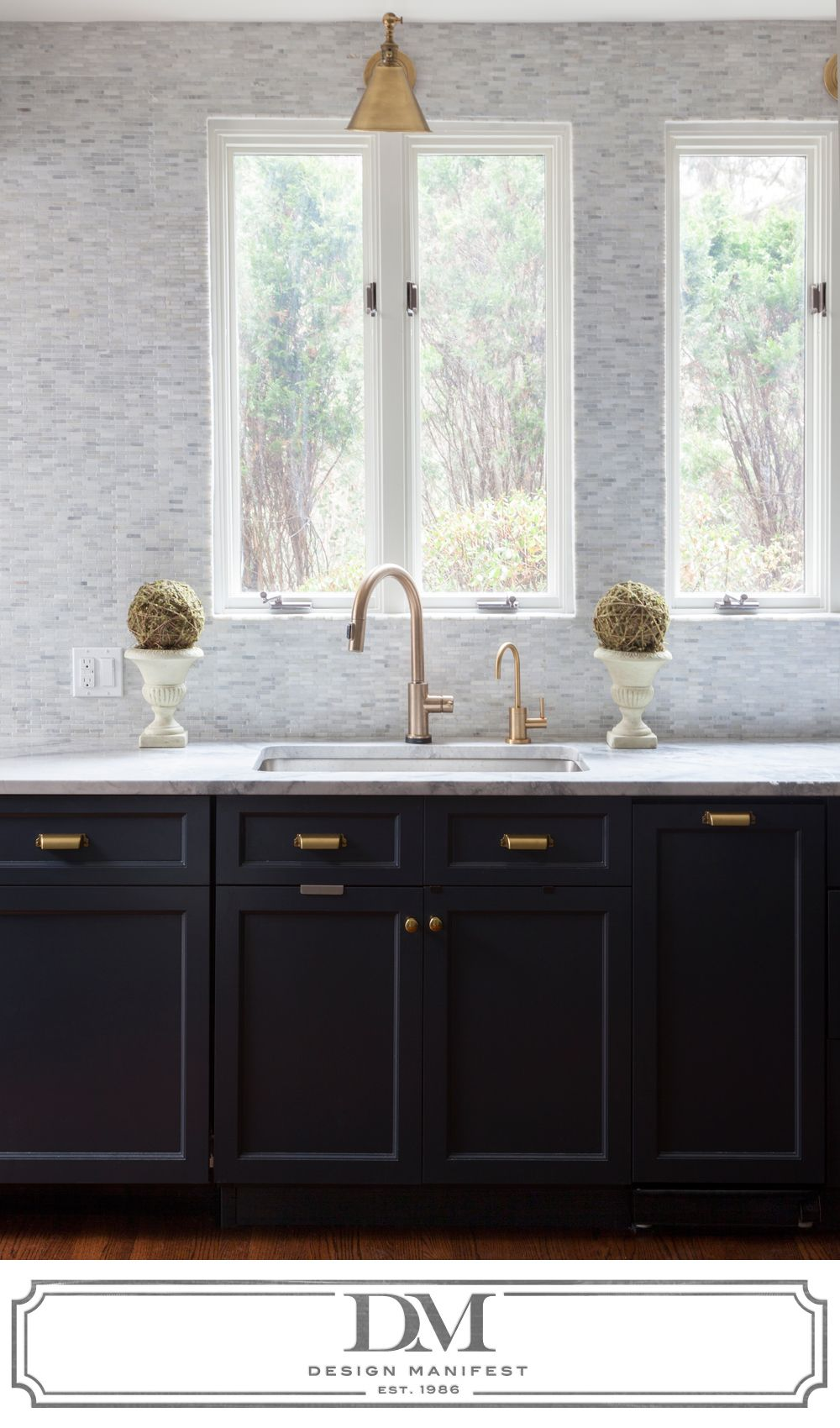 Kitchen window over sink  tumbled marble backsplash tile all the way up the wall sconce over