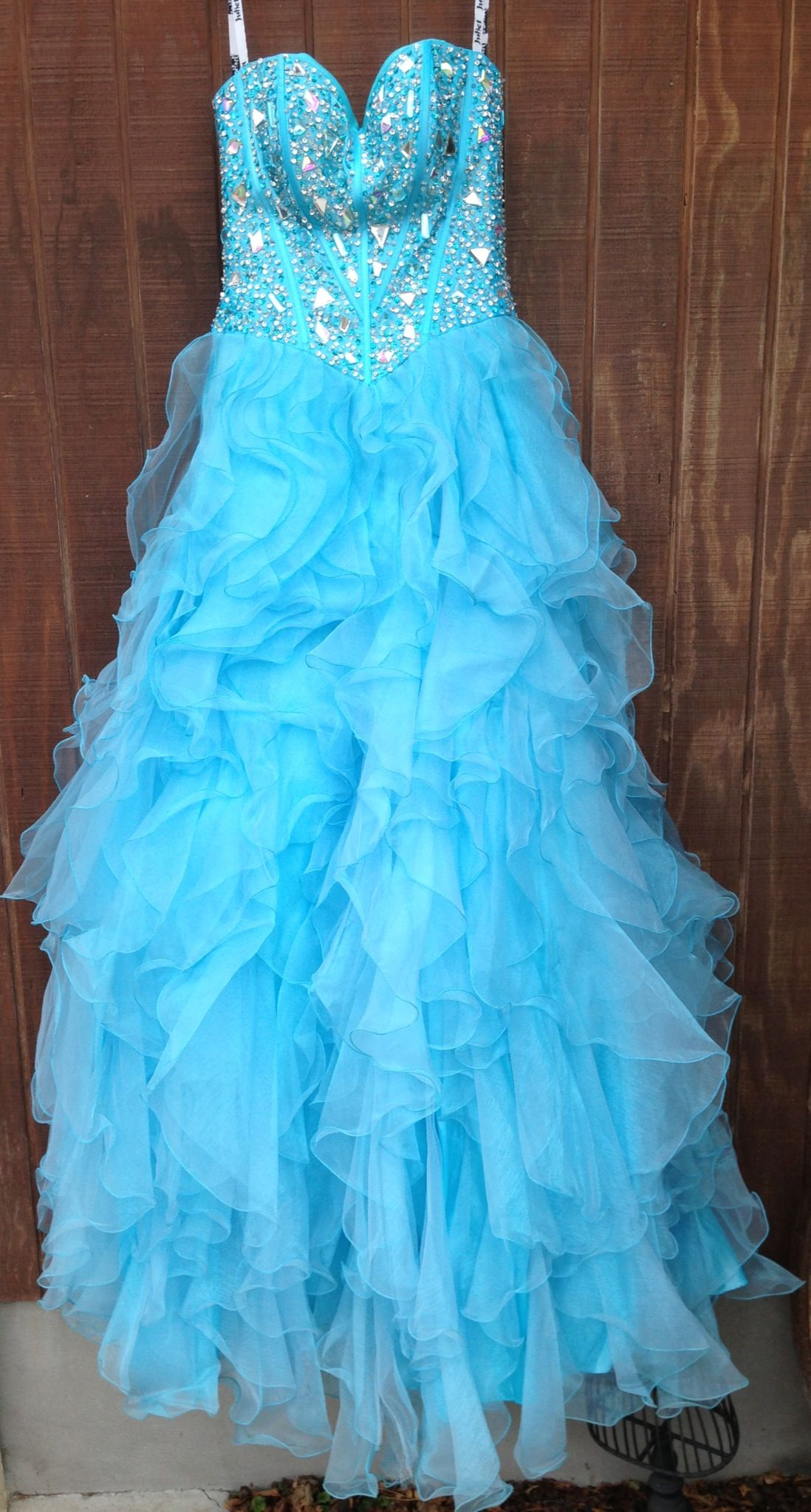 Blue ruffle prom dress available for rent at dazzling