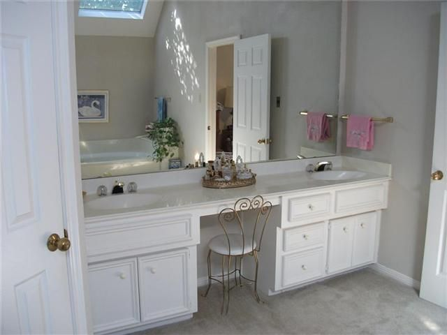 double sink bathroom vanity with makeup area | in master bath, the
