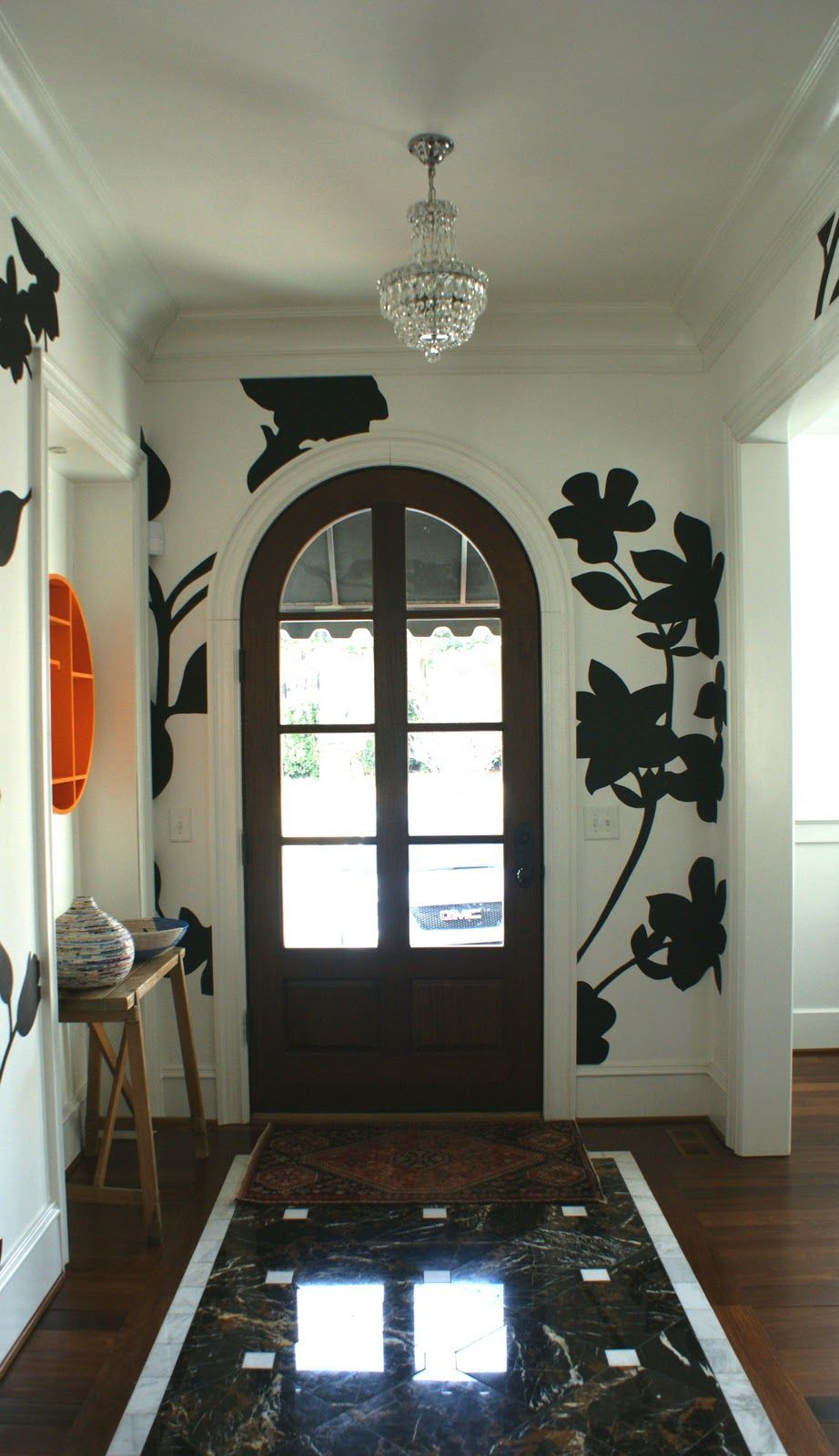 Handpainted walls by Raines Thompson. Designed by Ashley and Bonner Gaylord.