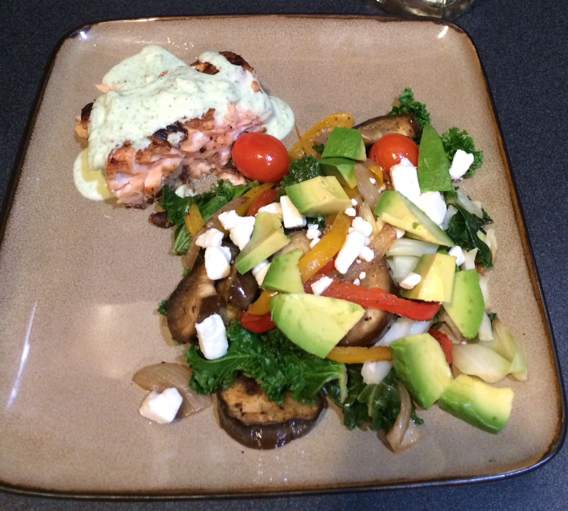 Pan seared salmon w/ a warm kale salad w/ eggplant, bell peppers, feta & avocado!