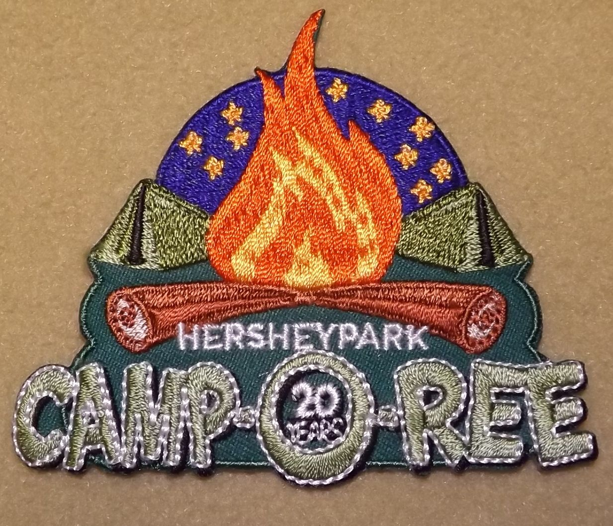 Girl scouts 100th Anniversary Year Hershey Park Camp-O-Ree patch. According to the 100th patch guru, this is a 100th year patch. Thank you, Theresa.
