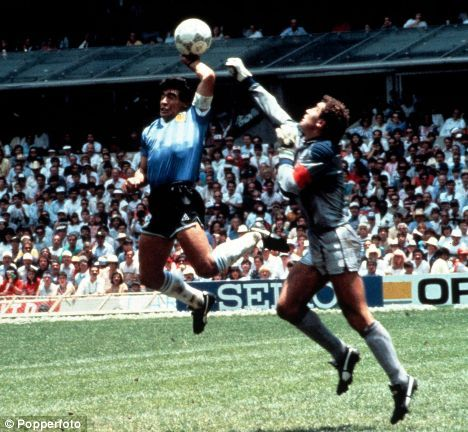 Hand of God: Maradona's 'goal' for Argentina against England in 1986   Read more: http://www.dailymail.co.uk/sport/football/article-1084654/Spurs-defender-Hutton-wait-shake-Hand-God-Scotland-face-Maradonas-Argentina-Hampden.html#ixzz3E5BkQHqK  Follow us: @MailOnline on Twitter | DailyMail on Facebook