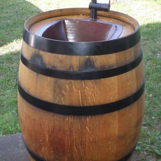 Turn a barrel into both a functional and decorative sink for outdoor use. You can use a variety of sinks and faucets to achieve the look or budget you desire.
