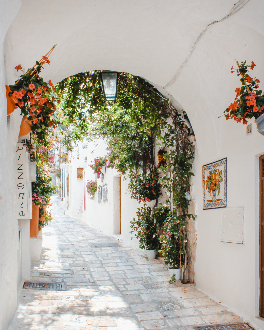 As soon as we moved to Italy, I wanted to explore the white alleys of Ostuni, the Trulli houses of Alberbello and the sandy beaches of Puglia. After a