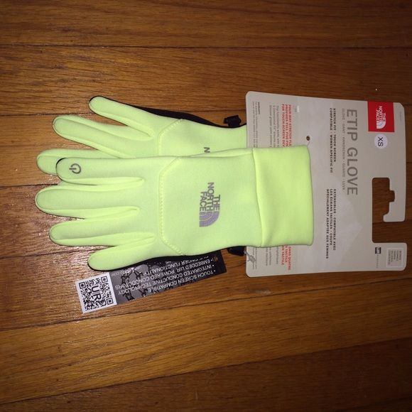 The North Face Etip Neon yellow XS gloves NWT The north face Etip gloves in size XS neon yellow NWT. Fit true to size as I normally wear a size small and these are a bit tight. One small mark as seen in the 4th picture. Also listed on Merc app The North Face Accessories Gloves & Mittens
