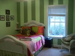 Green pinstriped bedroom on contrast wall.