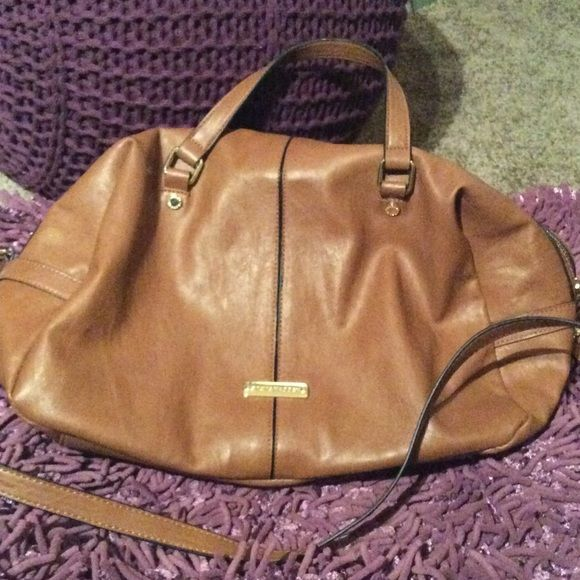 "Tan Purse Cute Steve Madden purse with two outer zip compartments, one interior zip and two interior pockets, has (1) 1/4 "" ink mark near opening zipper on the exterior. Steve Madden Bags Shoulder Bags"