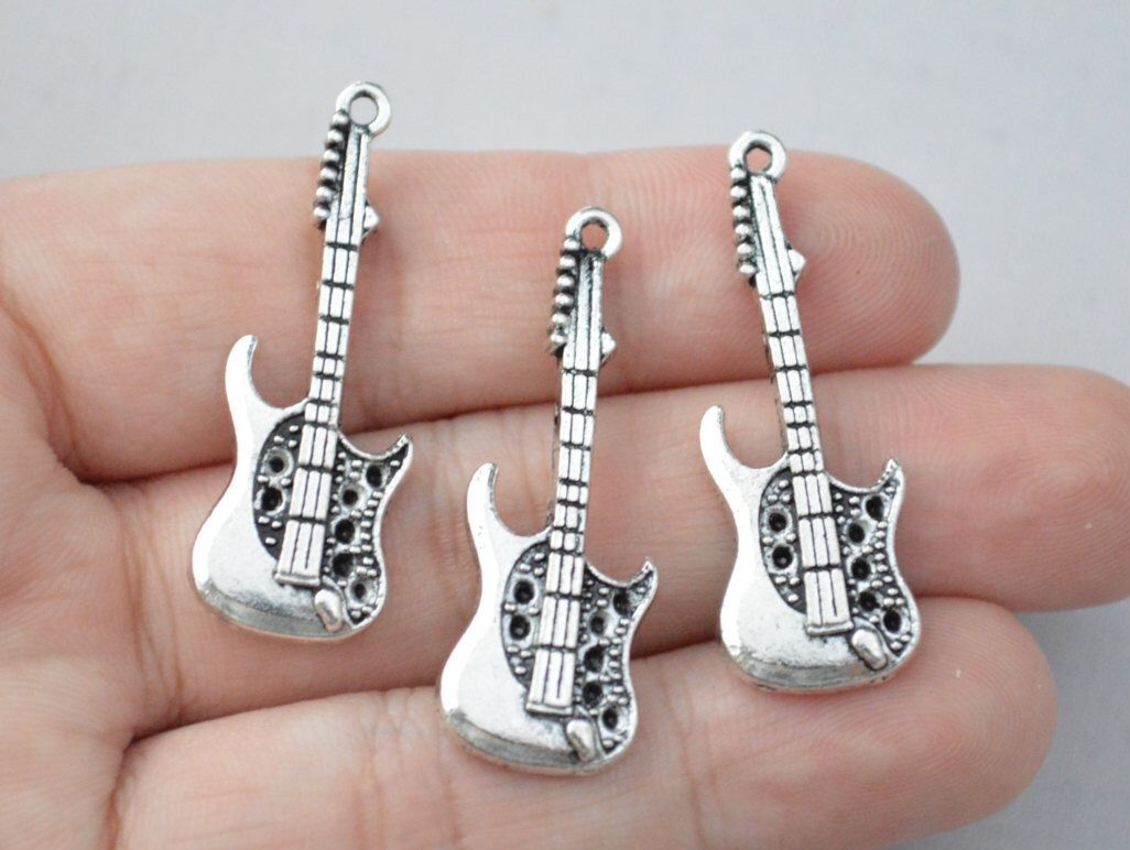 4 pcs electric guitar pendants guitar charms music charms antique 4 pcs electric guitar pendants guitar charms music charms antique silver tone 36x14mm yd0226 by aloadofball Choice Image