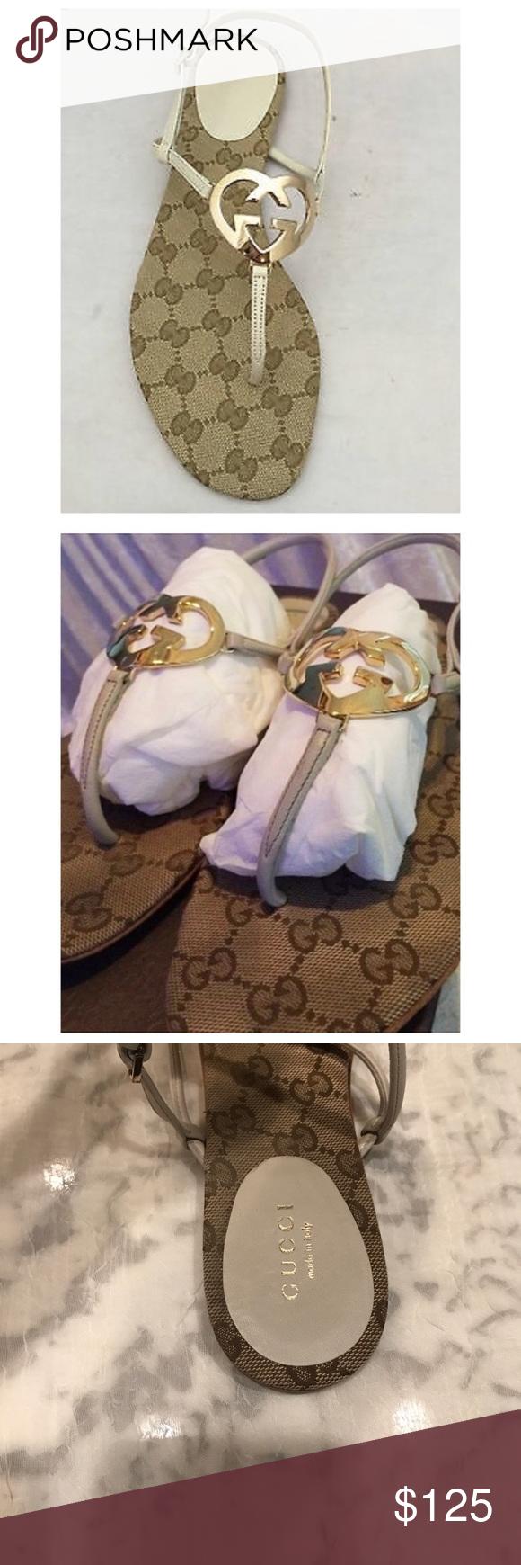 87e6112bc Gucci Gold interlocking G Heart Logo flat Sandal Gucci signature canvas flat  sandal, with interlocking G heart logo. Used sandal, with visible signs of  use, ...