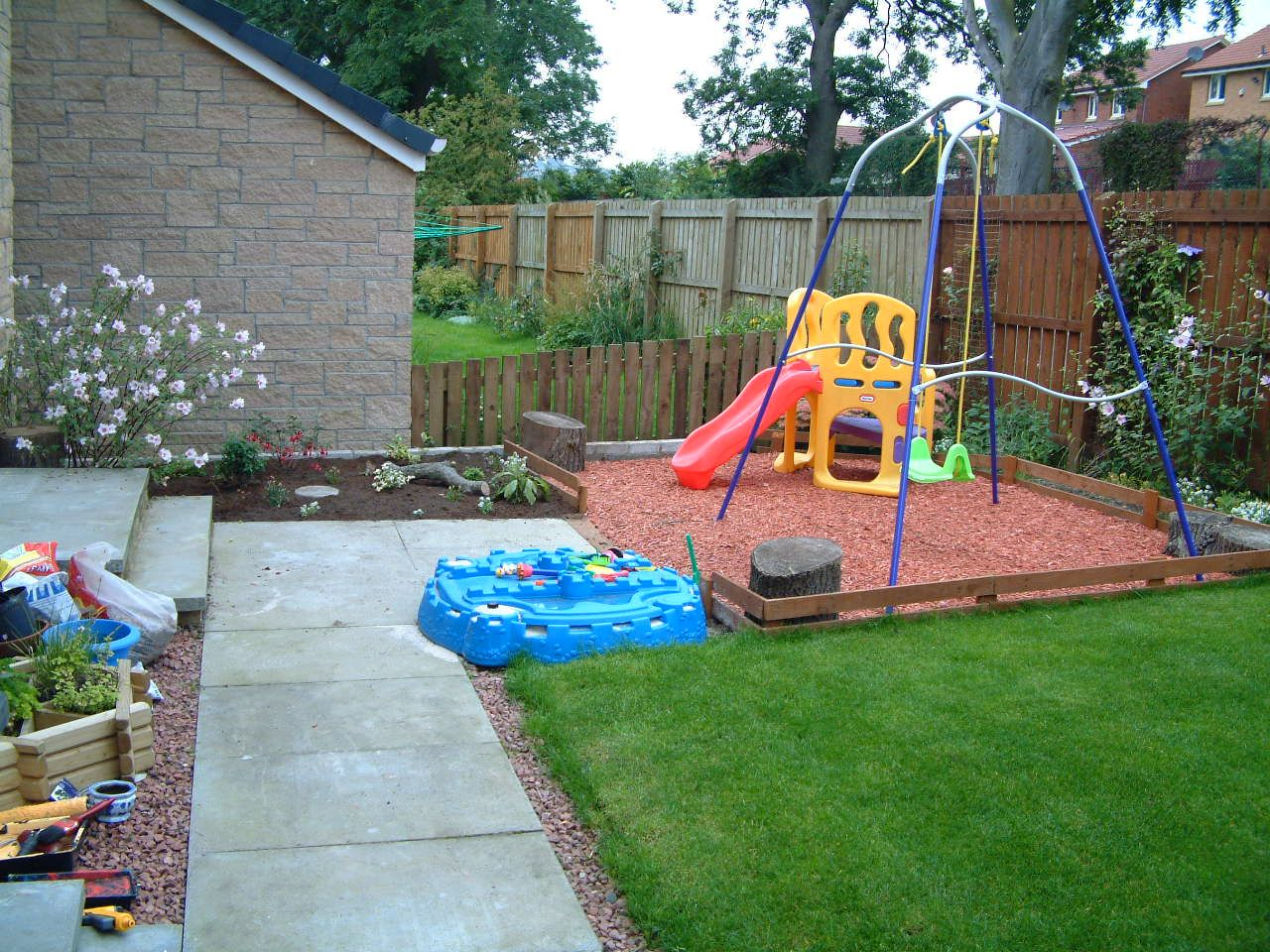 garden play area idea with rubber mulch