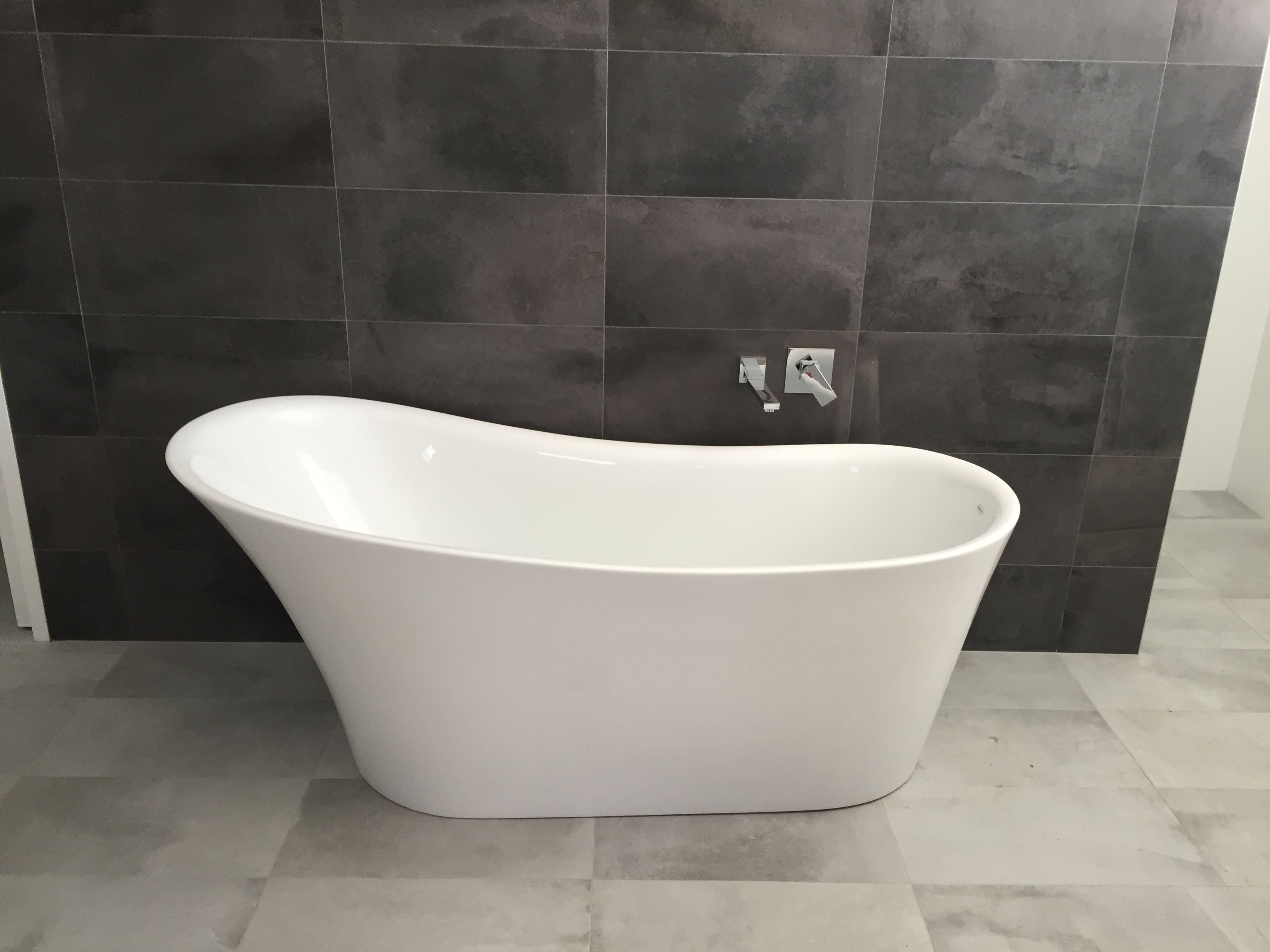 Freestanding Bath Dark Grey Feature Wall Light Grey Floor Tiles Toilet To Left Side Behind Wall Grey Feature Wall Dark Grey Feature Wall Free Standing Bath