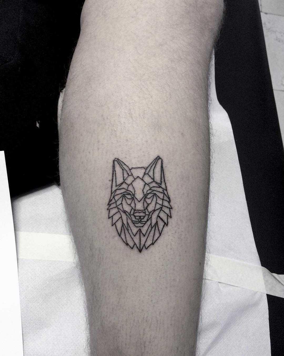 Geometric Wolf Head Tattoo On The Calf Geometric Wolf Tattoo Geometric Wolf Small Wolf Tattoo