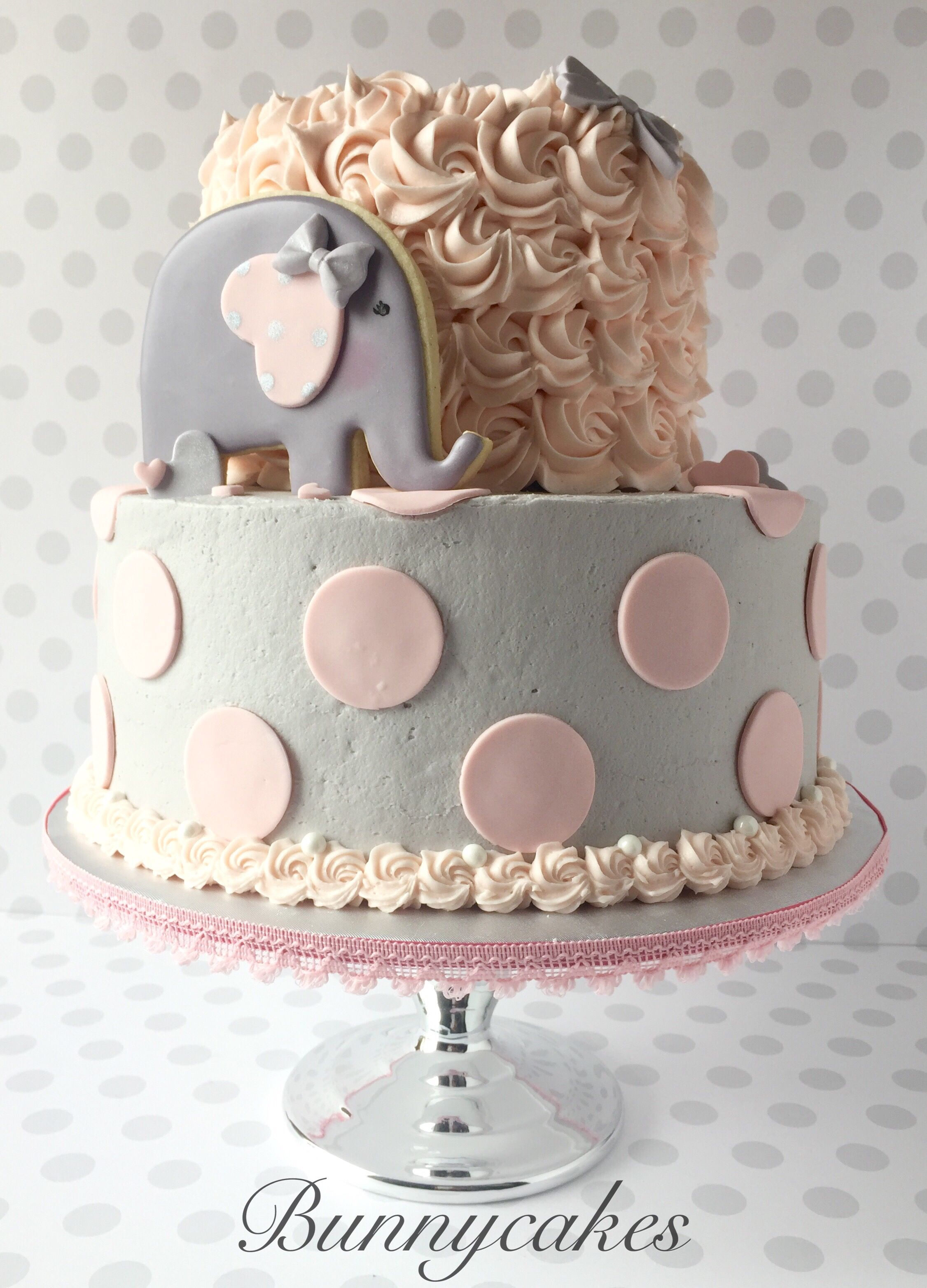 Adorable pink and gray elephant themed baby shower cake by