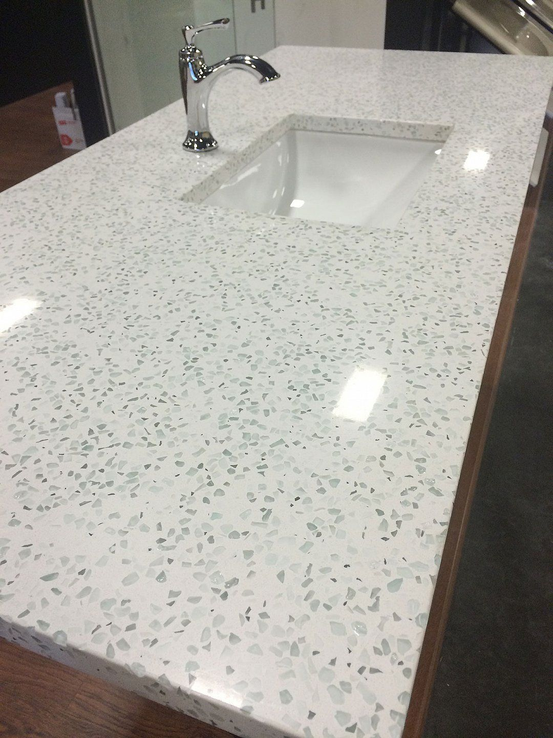 I Am Intrigued By Recycled Glass Countertops They Are A Bit Cheaper Than Quartz Curava In Action Glass Countertops Recycled Glass Countertops Diy Countertops