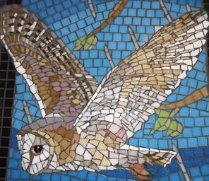 A mosaic barn owl flying. Part of the Shirley Towers Mosaic, created by Will Rosie owner of All About Art and a member of BAMM the British Association for Modern Mosaics