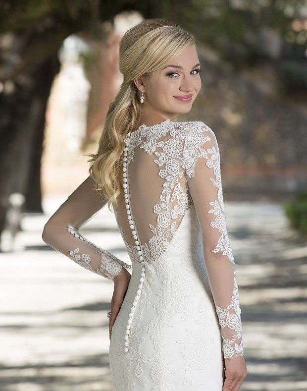 Illusion lace and tulle long sleeve fit and flare gown featuring a V-neckline with floating lace and a scalloped hem create this graceful gown.