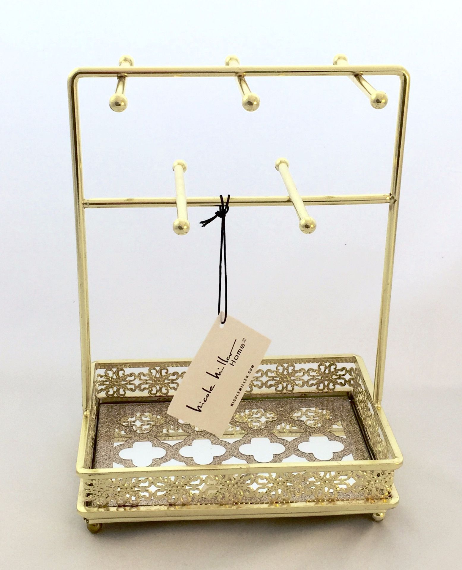This gold metal framed jewelry stand will make your dresser look