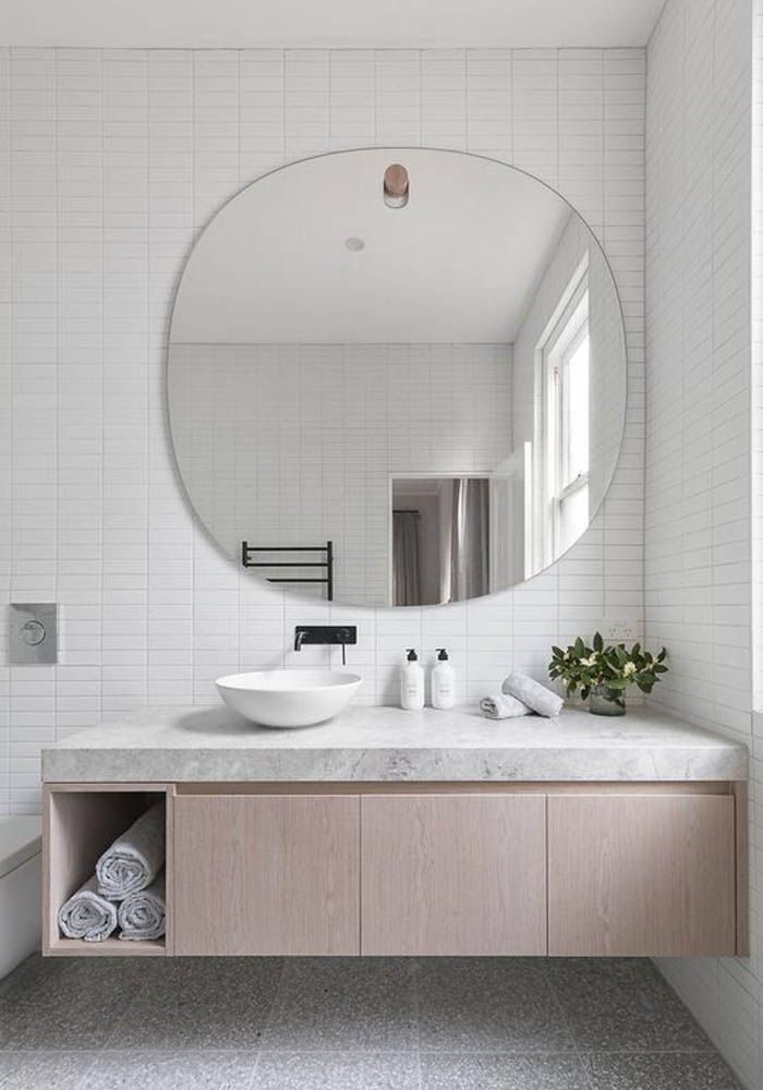 Big Round Mirror And Sleek Minimal Bathroom Cabinet With A Sink