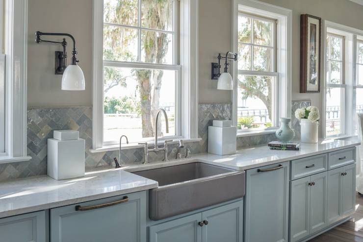 Lovely Kitchen Features Gray Base Cabinets Topped With