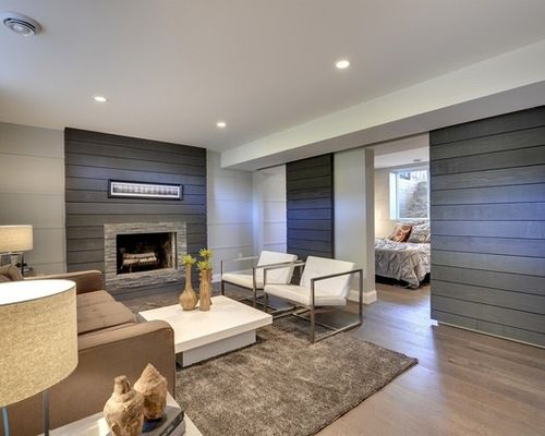 For the basement i like the shiplap wood feature walls for Modern finished basements