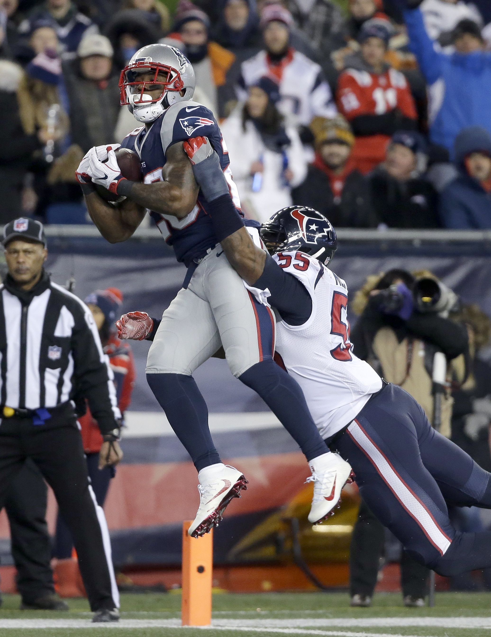New England Patriots Rb James White Is Carrying The Ball And His Defender Into The Endzone Ap New England Patriots Football New England Patriots James White