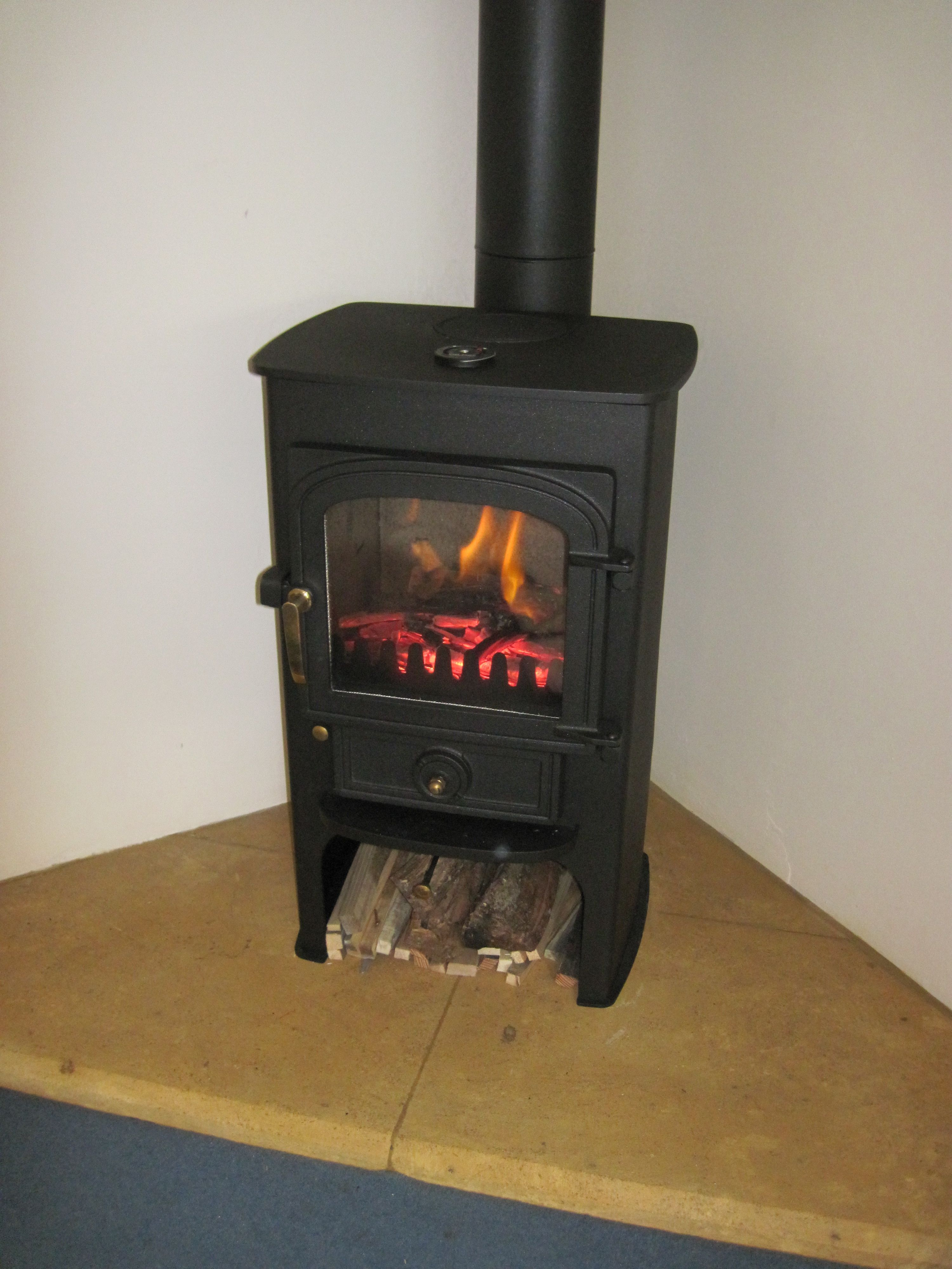 clearview pioneer 400p on a corner cotswold stone hearth with rear