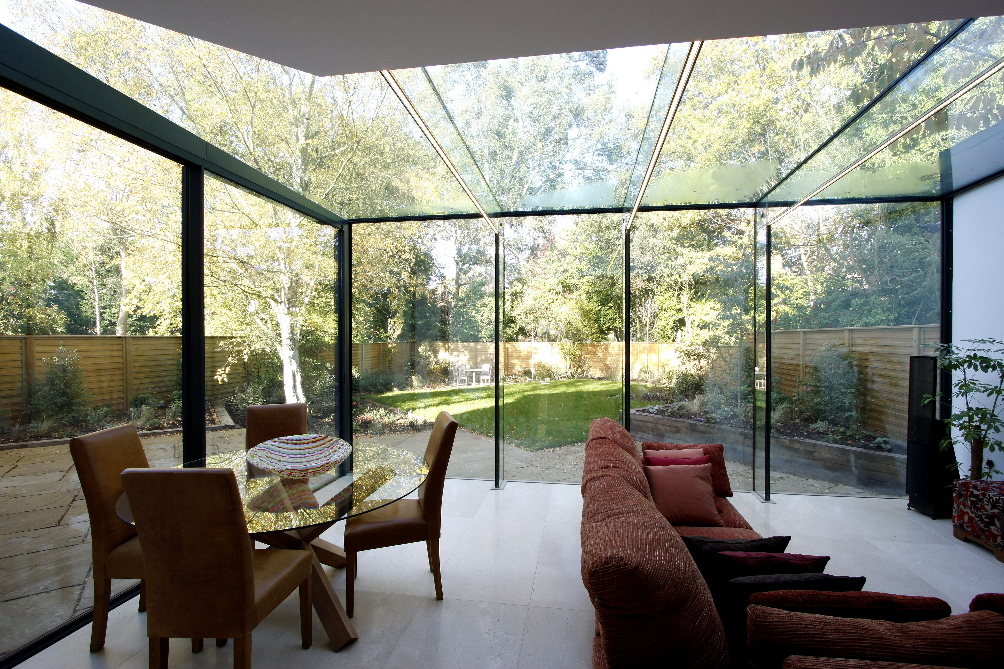 frameless glass box extension showing low iron glass beams. Black Bedroom Furniture Sets. Home Design Ideas