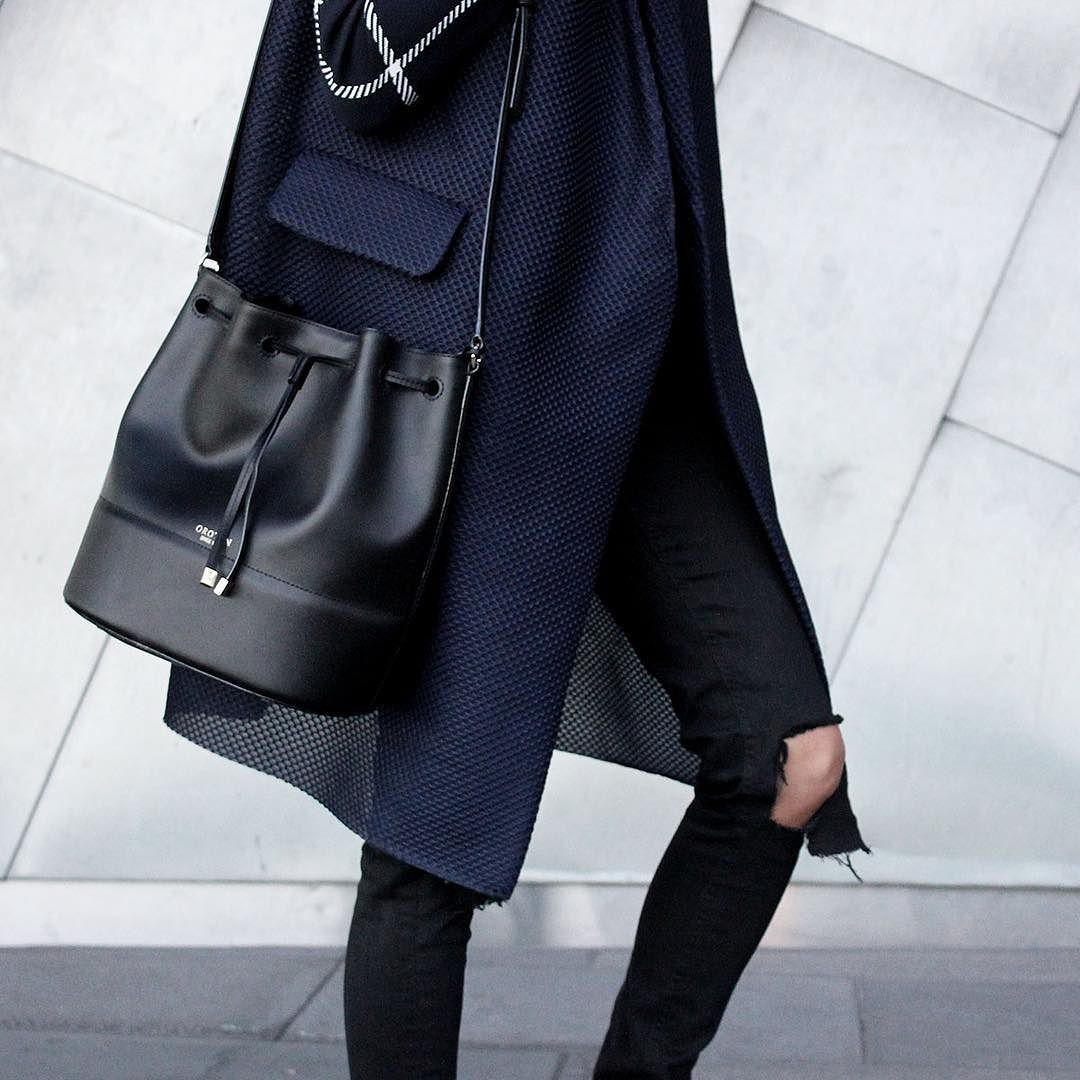 aa3de0d10 Essential style item: A black bucket bag.. @emily.highfield wears  @cosstores @oroton by stylebkofficial
