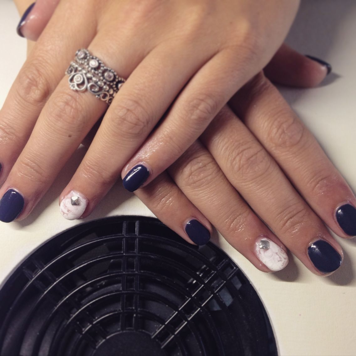 Navy CND Shellac set with white marble nail and stud detail