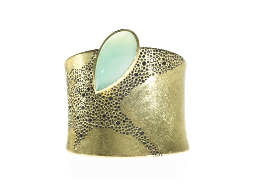 18ky gold cuff with black diamonds and gem silica