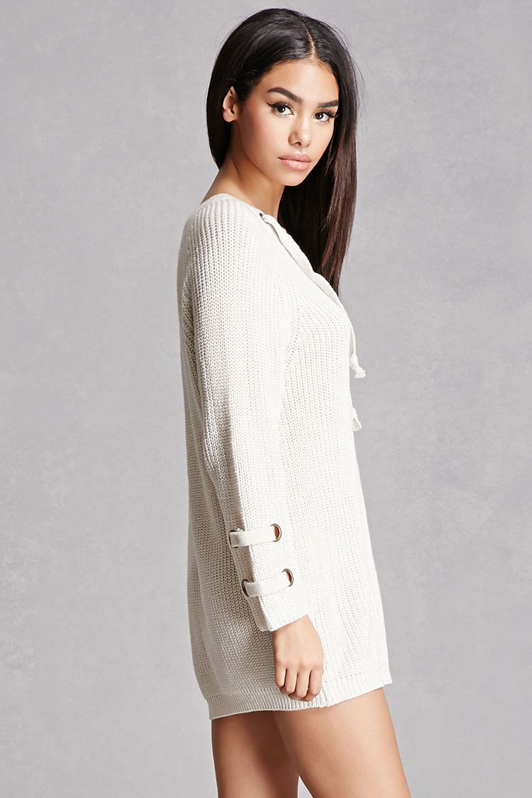 A marled knit sweater dress featuring a lace-up with grommets on the front and on each long sleeve, a V-neckline, and a mini length. This is an independent brand and not a Forever 21 branded item.