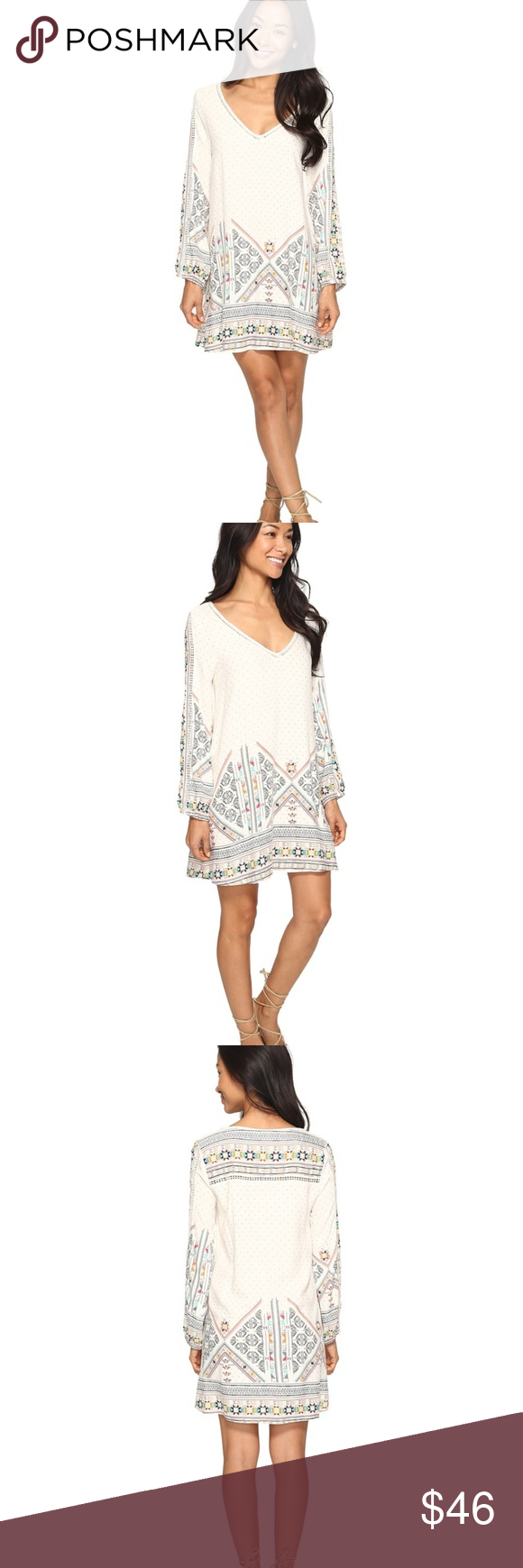 Roxy Dress Roxy Dress (Style-April Morning/Marshmellow Tex Mex Border) Cream colored with black, turquoise, orange, and red colors with geometric shapes. Lightweight dress perfect for summer as a swimsuit cover up or just as a sundress. New Roxy Dresses