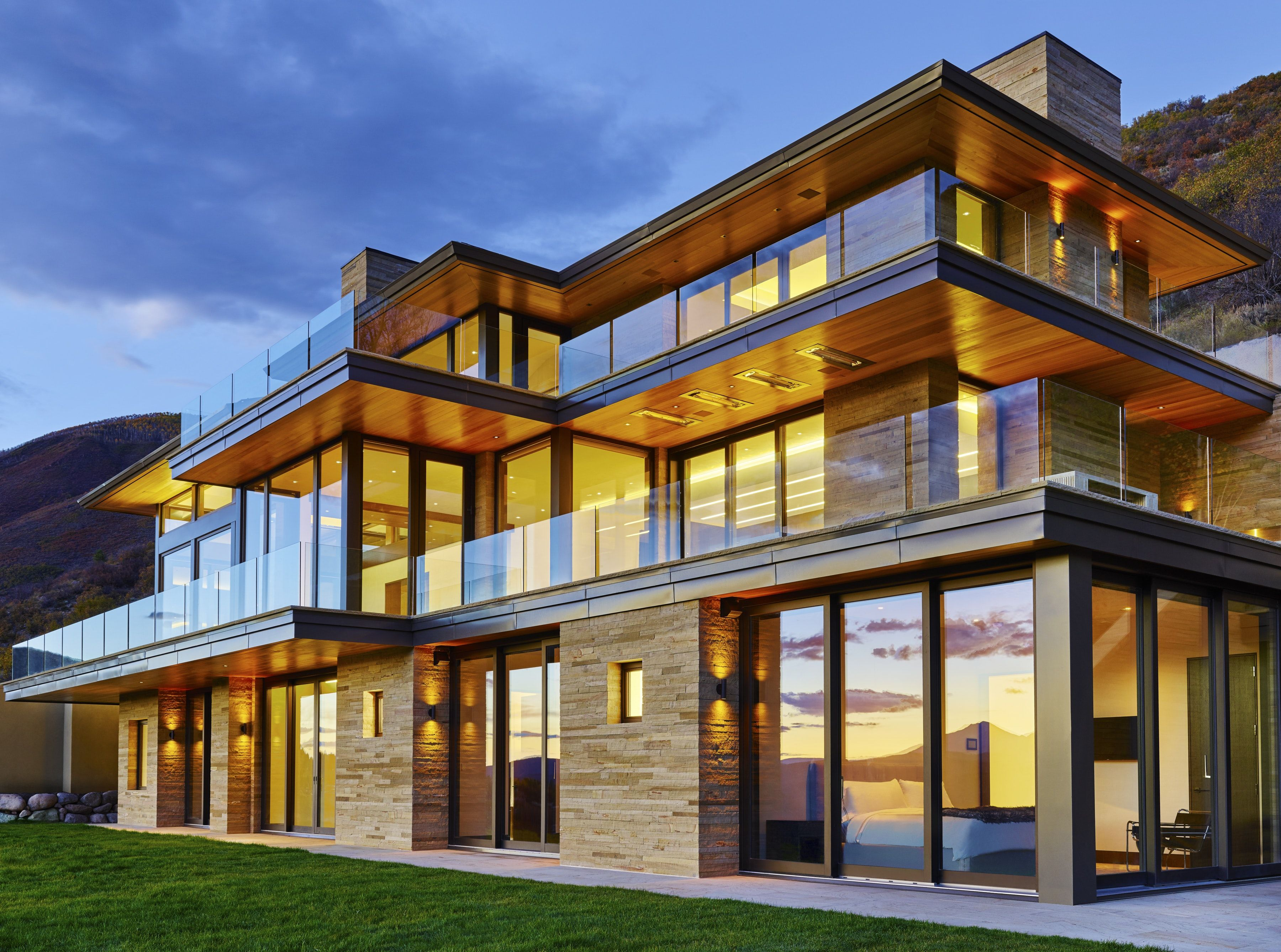 Mountain Home With Coursed Sandstone Veneer And Floor To Ceiling Windows Residential Architecture Architecture Portfolio Architecture