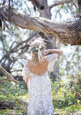 Bride with Open-Back Dress and Garland in Forest   Photography: Willa Kveta Photography. Read More:  http://www.insideweddings.com/weddings/romantic-outdoor-bohemian-chic-wedding-at-a-santa-barbara-park/755/