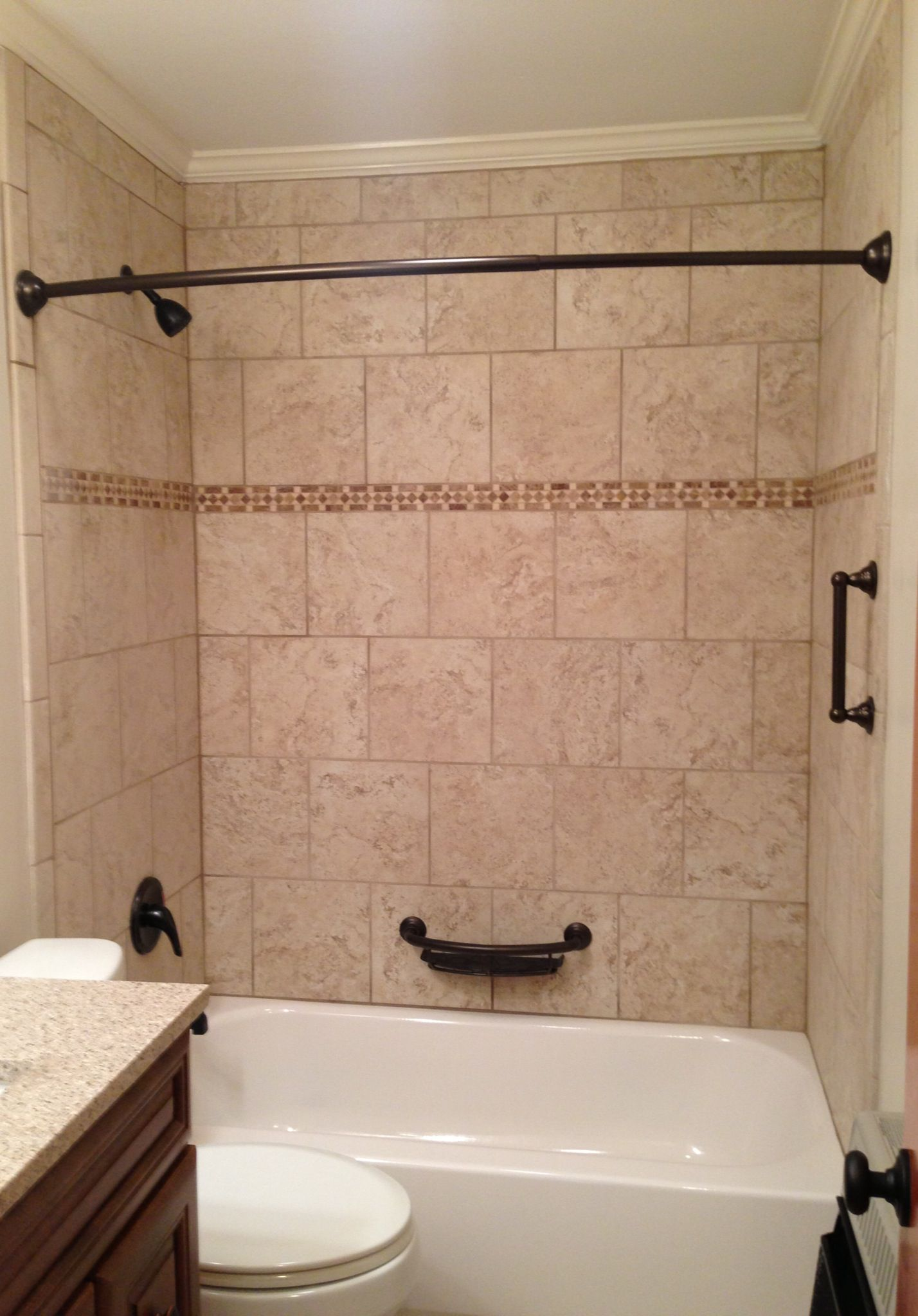 Tile tub surround. Beige tile bathtub surround with oil rubbed ...
