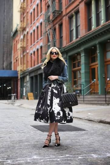 Street Style Trend: Fur Accessories - black fur stole paired with a full graphic black and white midi skirt + denim jacket, Chanel bag, and strappy heels