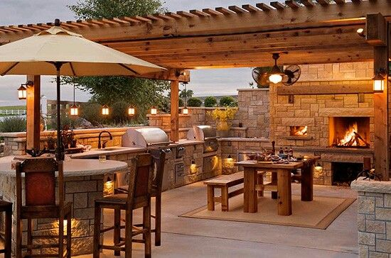 Tuscan Style Outdoor Kitchen Living Room And Bar With Grills And