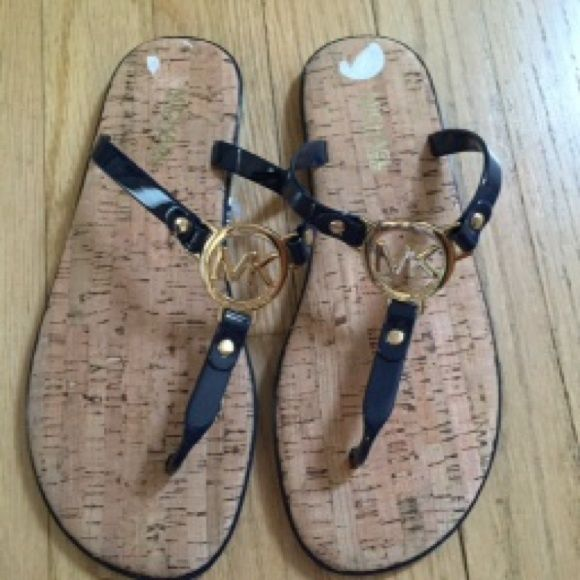 Michael kors navy blue jelly flip flop sandal 11 New without box Charm is gold More sizes/ colors available If you don't see your size available in my closet please message me MICHAEL Michael Kors Shoes