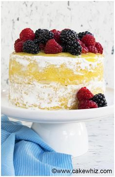 This moist lemon cake recipe with lemon curd and seven minute frosting is made from scratch and great for Summer. It's soft and bursting with lemon flavors.