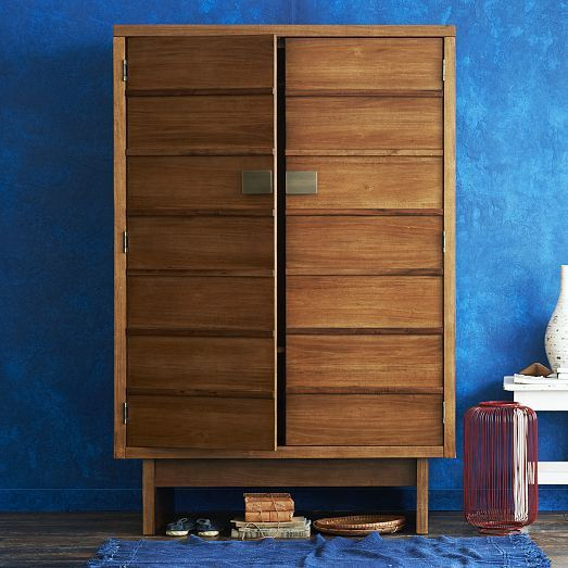 Influenced by both Asian and mid-century modern design, the Shoji Armoire's acorn-stained finish highlights the rich eucalyptus wood grain. Use it to store anything from dresses and suits to flat screens.
