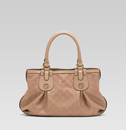 7fc804c481f8 Gucci  Scarlett  medium tote with studded interlocking G detail ...