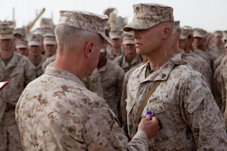 The Commandant of the Marine Corps Gen. James F. Amos pins a Purple Heart on Sgt. Shane Fredericks during a visit to Combat Outpost Shir Ghazi, Afghanistan, July 17, 2012. Fredericks, from Syracuse, N.Y., and an infantryman with 2nd Battalion, 5th Marine Regiment, suffered a concussion when the vehicle he was riding in struck an improvised explosive device explosion in Now Zad District, May 12, 2012. General Amos and Sgt. Maj. of the Marine Corps Micheal P. Barrett visited Marines throughout…