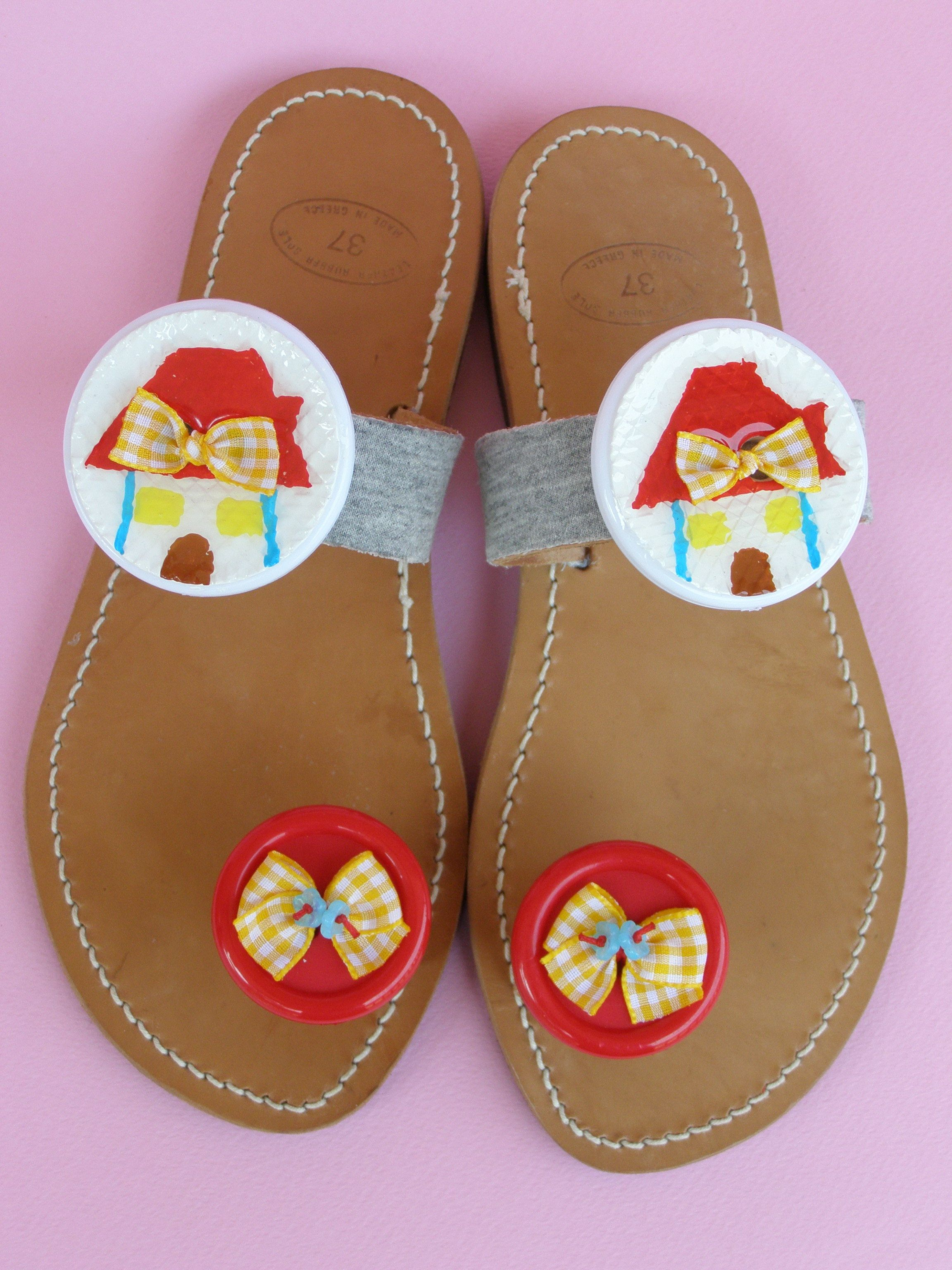 Handmade leather sandals with handpainted buttons,glass beads and French ribbons.
